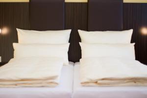 Ein Bett oder Betten in einem Zimmer der Unterkunft Pension Katharinenschule