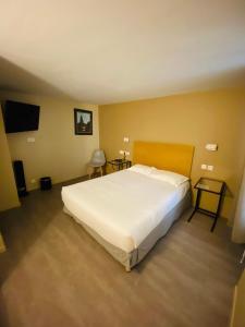 Кровать или кровати в номере Marmotel Etoile