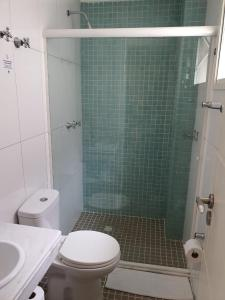 Um banheiro em SW Praia Hotel