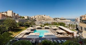 A view of the pool at Radisson Blu Hotel Marseille Vieux Port or nearby