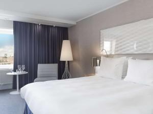 A bed or beds in a room at Radisson Blu Scandinavia Hotel Aarhus