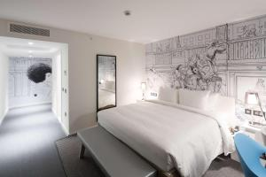A bed or beds in a room at Radisson RED Hotel, Glasgow