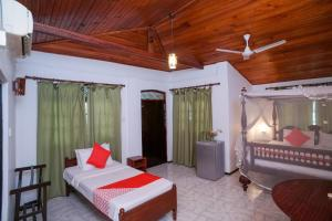 A bed or beds in a room at Sea view Beach Resort