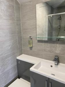 A bathroom at The Promenade Guest House