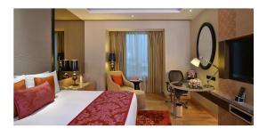 A television and/or entertainment centre at Radisson Blu Jaipur