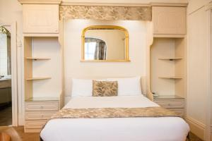 A bed or beds in a room at Clifton Park Hotel - Exclusive to Adults
