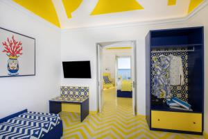 A television and/or entertainment center at Imperati Suites by Alcione Residence
