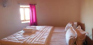 A bed or beds in a room at Golden villa