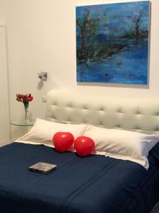 A bed or beds in a room at Les Chambres de Françoise