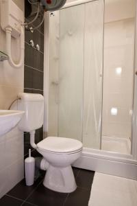 A bathroom at Borna and Franko Rooms