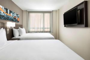 Un ou plusieurs lits dans un hébergement de l'établissement Hyatt Place New York City/Times Square
