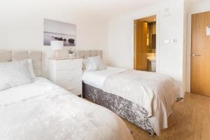 A bed or beds in a room at Mackie Exclusive Residence