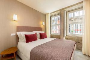Uma cama ou camas num quarto em Your Opo Ribeira Apartments Porto