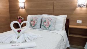 Cama ou camas em um quarto em Planet Dunas Residence