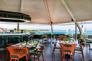 A restaurant or other place to eat at The Kuta Beach Heritage Hotel - Managed by Accor