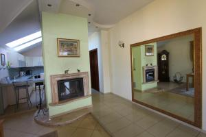 A kitchen or kitchenette at Luxurious apartment for rent in Klaipeda, with two bedrooms