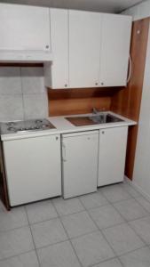 A kitchen or kitchenette at Capricornio Club