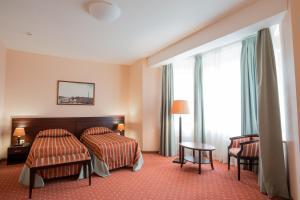 Кровать или кровати в номере МФК Горный