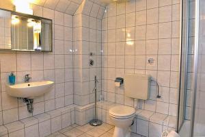 Ein Badezimmer in der Unterkunft Pension Bloo Tomato