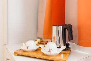 Coffee and tea-making facilities at City Résidence Strasbourg Centre