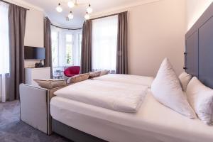 Ein Bett oder Betten in einem Zimmer der Unterkunft Villa Rein Boutiquehotel