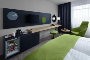 Телевизор и/или развлекательный центр в Spa Hotel Felicitas