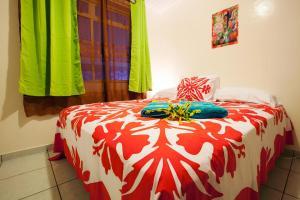 Cama ou camas em um quarto em Farehau