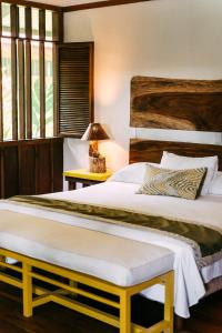 A bed or beds in a room at Mawamba Lodge