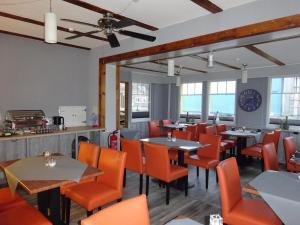 Een restaurant of ander eetgelegenheid bij Haus Meeresblick