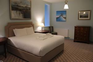 A bed or beds in a room at The Highland Club