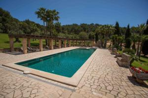 The swimming pool at or near Hotel Rural Son Terrassa