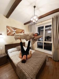 Кровать или кровати в номере Гостевой дом Горная долина