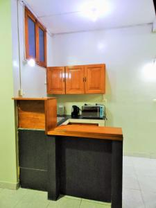 A kitchen or kitchenette at Mini Departamento Iquitos 1245-01