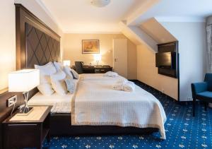 Un ou plusieurs lits dans un hébergement de l'établissement Hotel Kampa