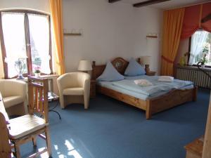 A bed or beds in a room at Landhaus Sassenhof