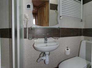 Ванна кімната в Casa del Pozitiff