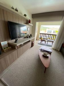 A television and/or entertainment center at Buzios Beach Resort Residencial 2501e2502