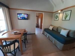 A seating area at Miradores del Bosque Apart & Spa