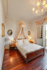 A bed or beds in a room at Dalat Palace Heritage Hotel