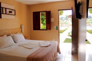 Cama ou camas em um quarto em Pousada Badejo