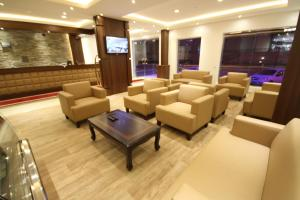 O lounge ou bar de Nozol Al Rayyan Hotel Apartments