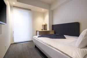 A bed or beds in a room at Tokyu Stay Osaka Hommachi