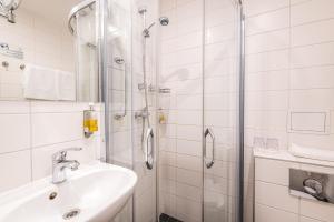 A bathroom at Liva Hotel