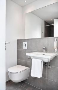 Et badeværelse på HORISONT Hotel & Konference