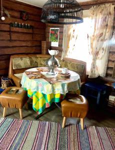 A restaurant or other place to eat at Dom V Russkom Stile