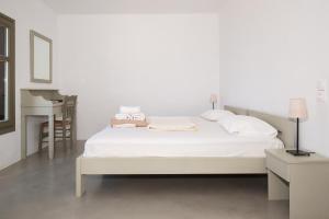 A bed or beds in a room at Petradi Studios & Villa