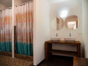 A bathroom at Colorbox beds and rooms by Milenium