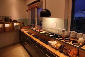 Кухня или мини-кухня в Hotel Alea City
