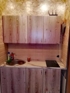 Кухня или мини-кухня в Apartment Druzhby 32