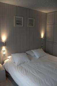 Cama o camas de una habitación en A Casa
